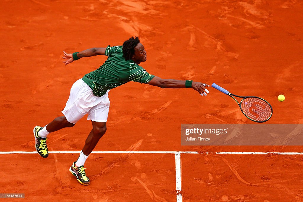 Gael Monfils of France loses his racquet as he stretches for a shot in his Men's Singles match against Pablo Cuevas of Uruguay on day six of the 2015 French Open at Roland Garros on May 29, 2015 in Paris, France.