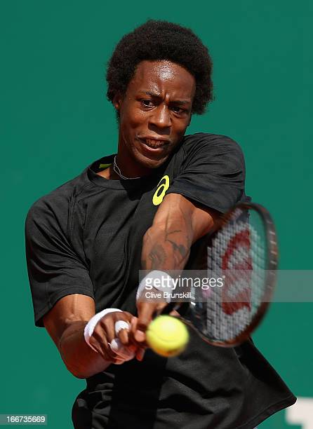 Gael Monfils of France plays a backhand against Albert Montanes of Spain in their first round match during day three of the ATP Monte Carlo...