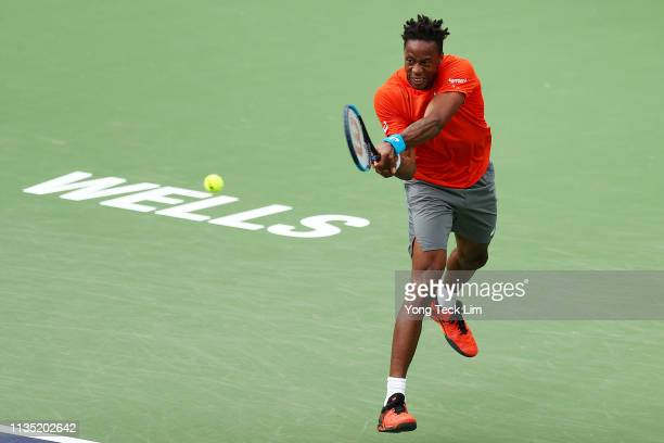 Gael Monfils of France plays a backhand against Albert RamosVinolas of Spain during their men's singles third round match on Day 8 of the BNP Paribas...