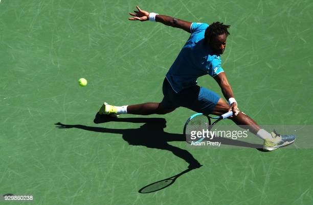 Gael Monfils of France plays a backhand during his match against Matthew Ebden of Australia during the BNP Paribas Open at the Indian Wells Tennis...