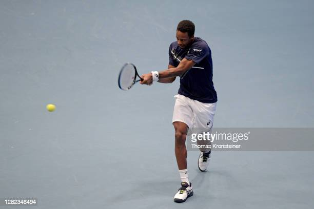 Gael Monfils of France plays a backhand during his match against Pablo Carreno Busta of Spain during day three of the Erste Bank Open tennis...