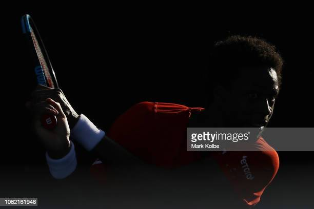 Gael Monfils of France plays a backhand in his first round match against Damir Dzumhur of Bosnia and Herzegovina during day one of the 2019...