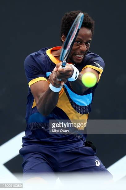 Gael Monfils of France plays a backhand in his Men's Singles first round match against Emil Ruusuvuori of Finland during day one of the 2021...