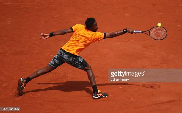 Gael Monfils of France plays a backhand in his men's singles third round match against Richard Gasquet of France during day eight of the French Open...