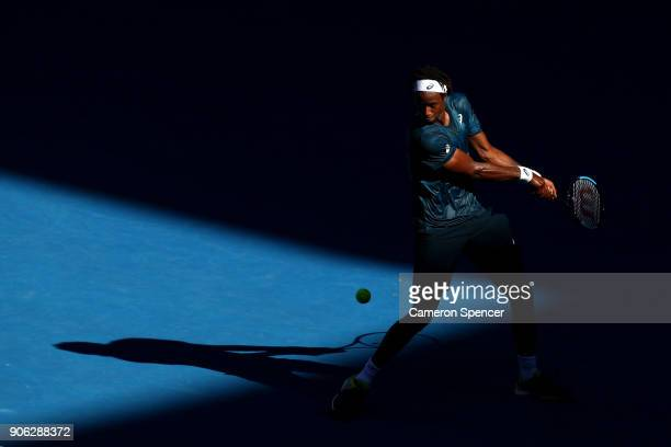 Gael Monfils of France plays a backhand in his second round match against Novak Djokovic of Serbia on day four of the 2018 Australian Open at...