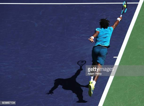 Gael Monfils of France plays a forehand during his match against Matthew Ebden of Australia during the BNP Paribas Open at the Indian Wells Tennis...