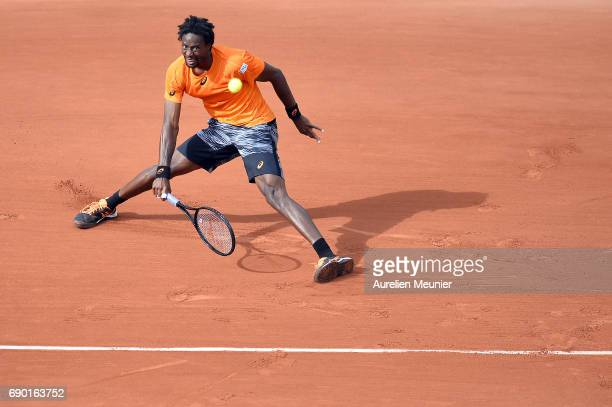 Gael Monfils of France plays a forehand during his men's single match against Dustin Brown of Germany on day three of the 2017 French Open at Roland...