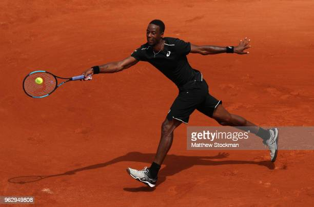 Gael Monfils of France plays a forehand during his men's singles first round match match against Elliot Benchetrit of France during day one of the...