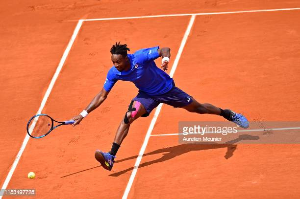Gael Monfils of France plays a forehand during his mens singles fourth round match against Dominic Thiem of Austria during day nine of the 2019...