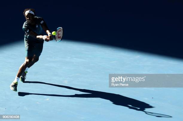 Gael Monfils of France plays a forehand during his second round match against Novak Djokovic of Serbia on day four of the 2018 Australian Open at...