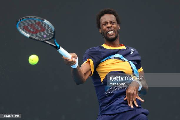 Gael Monfils of France plays a forehand in his Men's Singles first round match against Emil Ruusuvuori of Finland during day one of the 2021...