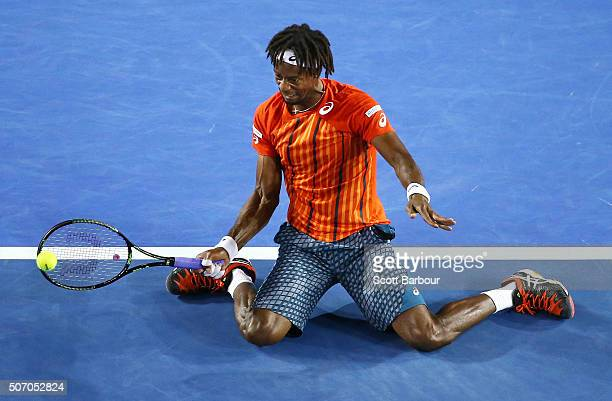 Gael Monfils of France plays a forehand while on his knees in his quarter final match against Milos Raonic of Canada during day 10 of the 2016...