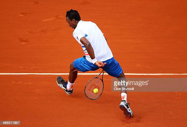Gael Monfils of France plays a shot through his legs during his men's singles match against Guillermo GarciaLopez of Spain on day nine of the French...