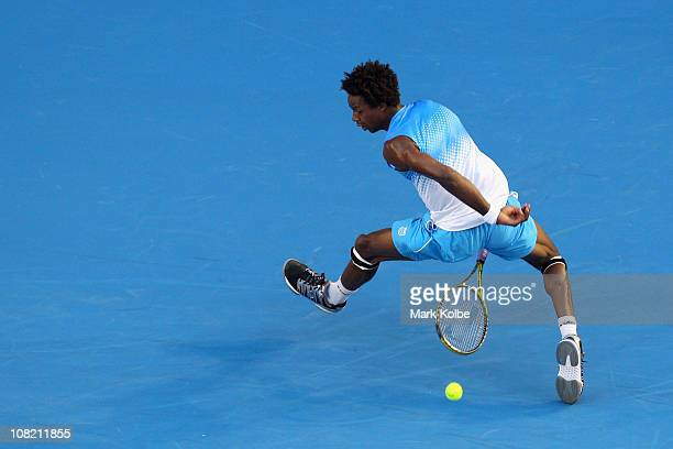 Gael Monfils of France plays a shot through his legs in his third round match against Stanislas Wawrinka of Switzerland during day five of the 2011...