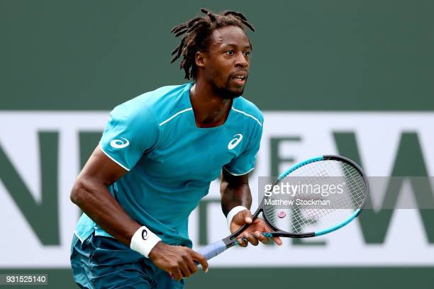 Gael Monfils of France plays PierreHugues Herbert of France during the BNP Paribas Open at the Indian Wells Tennis Garden on March 13 2018 in Indian...