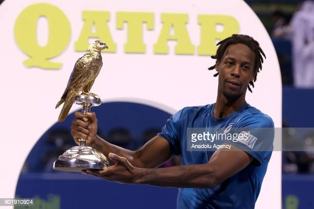 Gael Monfils of France poses with the trophy after winning against Andrey Rublev of Russia in the Qatar ExxonMobil Open 2018 Tennis Tournament Men's...