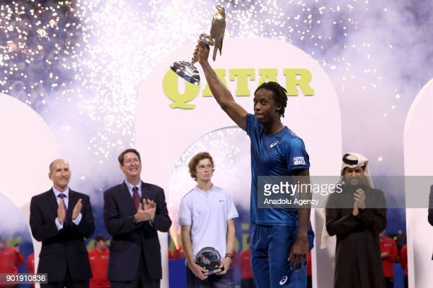 Gael Monfils of France raises the trophy after winning against Andrey Rublev of Russia in the Qatar ExxonMobil Open 2018 Tennis Tournament Men's...