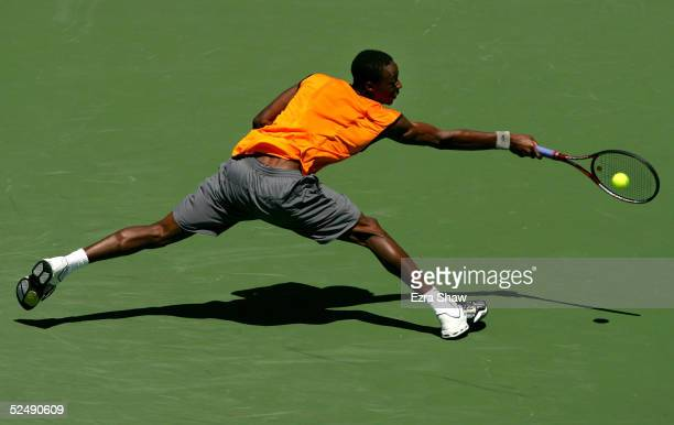 Gael Monfils of France reaches to return to Dominik Hrbaty of Slovakia during the NASDAQ100 Open at the Crandon Park Tennis Center on March 29 2005...