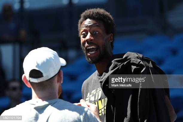 Gael Monfils of France reacts after Elina Svitolina of Ukraine wins her Women's Singles first round match against Marie Bouzkova of Czech Republic...