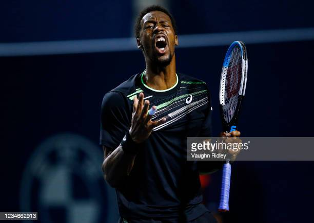 Gael Monfils of France reacts after losing a point against John Isner of the United States during a quarterfinal match on Day Five of the National...
