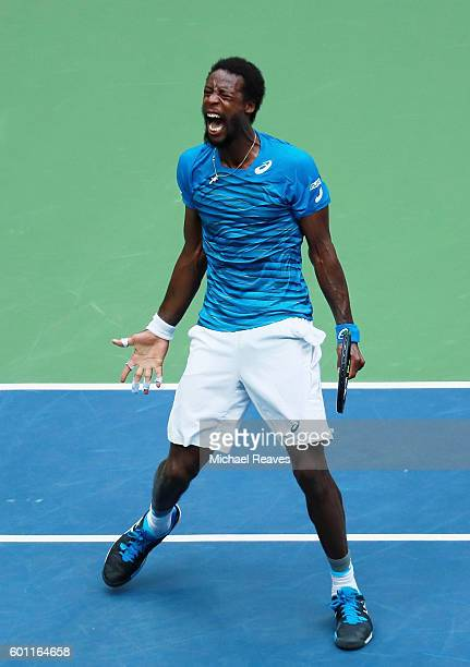 Gael Monfils of France reacts after winning the third set against Novak Djokovic of Serbia during their Men's Singles Semifinal Match on Day Twelve...