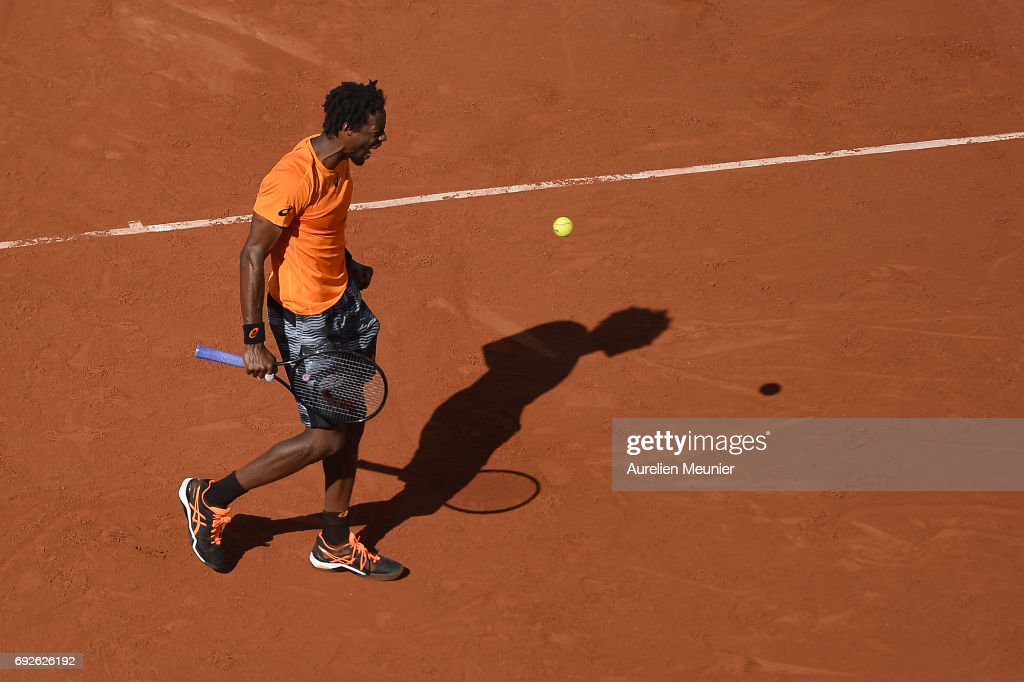 Gael Monfils of France reacts during the men's singles fourth round match against Stanislas Wawrinka of Switzerland on day nine of the 2017 French Open at Roland Garros on June 5, 2017 in Paris, France