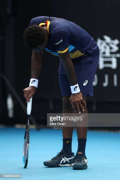 Gael Monfils of France reacts in his Men's Singles first round match against Emil Ruusuvuori of Finland during day one of the 2021 Australian Open at...