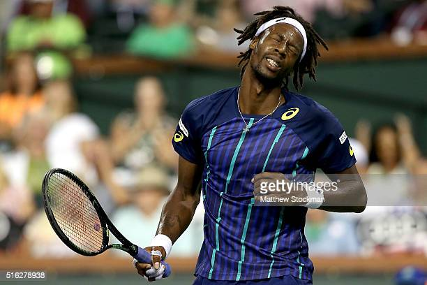 Gael Monfils of France reacts to a lost point while playing Milos Raonic of Canada during the BNP Paribas Open at the Indian Wells Tennis Garden on...
