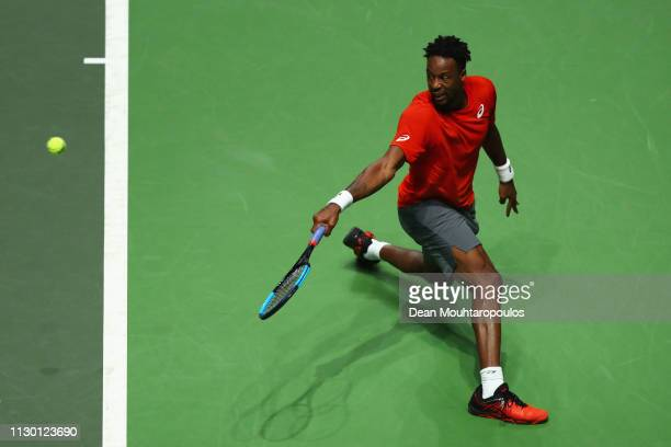 Gael Monfils of France returns a backhand against Daniil Medvedev of Russia in their semi final match during Day 6 of the ABN AMRO World Tennis...