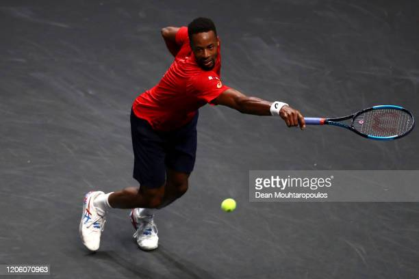 Gael Monfils of France returns a backhand against Gilles Simon of France during Day 6 of the ABN AMRO World Tennis Tournament at Rotterdam Ahoy on...