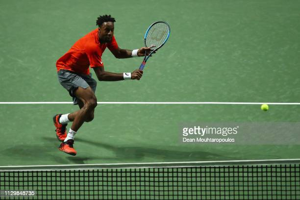 Gael Monfils of France returns a backhand to Damir Dzumhur of Bosnia and Herzegovina in their quarter final during Day 5 of the ABN AMRO World Tennis...