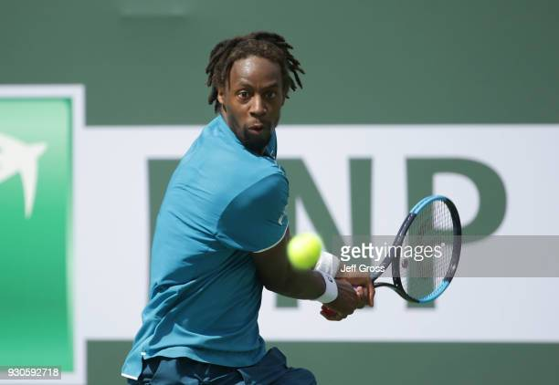 Gael Monfils of France returns a backhand to John Isner during the BNP Paribas Open on March 11 2018 at the Indian Wells Tennis Garden in Indian...