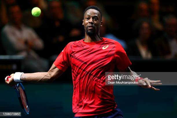 Gael Monfils of France returns a forehand against Gilles Simon of France during Day 6 of the ABN AMRO World Tennis Tournament at Rotterdam Ahoy on...