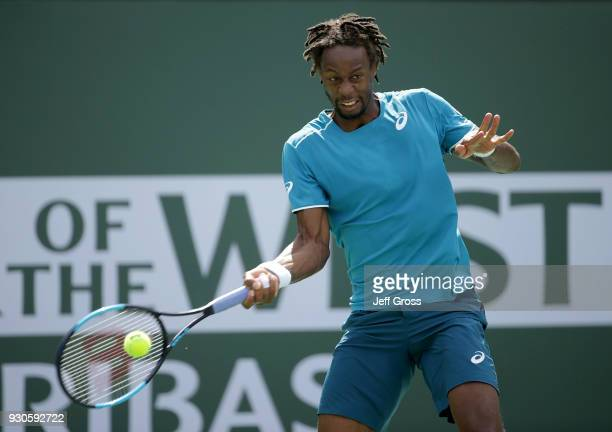 Gael Monfils of France returns a forehand to John Isner during the BNP Paribas Open on March 11 2018 at the Indian Wells Tennis Garden in Indian...