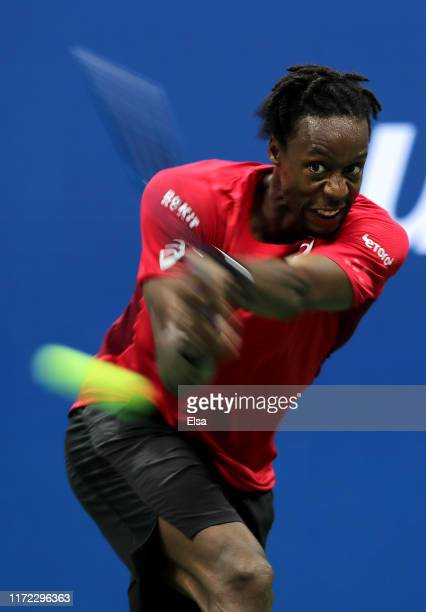 Gael Monfils of France returns a shot during his Men's Singles quarterfinal match against Matteo Berrettini of Italy on day ten of the 2019 US Open...