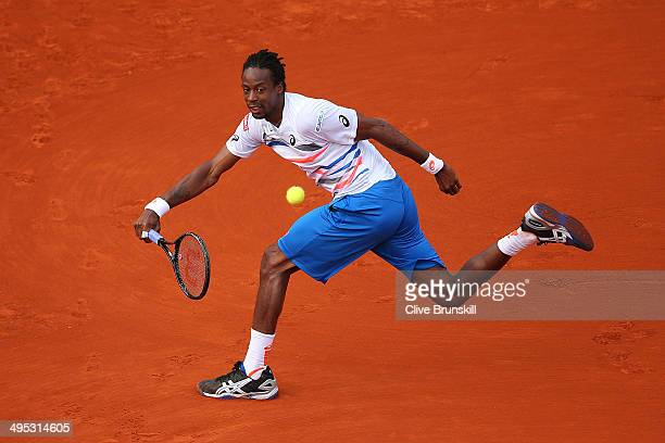 Gael Monfils of France returns a shot during his men's singles match against Guillermo GarciaLopez of Spain on day nine of the French Open at Roland...