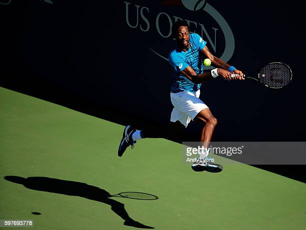 Gael Monfils of France returns a shot to Gilles Muller of Luxembourg during his first round Men's Singles match on Day One of the 2016 US Open at the...