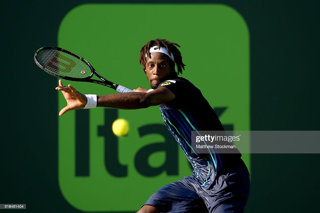 Gael Monfils of France returns a shot to Kei Nishikori of Japan during the Miami Open presented by Itau at Crandon Park Tennis Center on March 31, 2016 in Key Biscayne, Florida.
