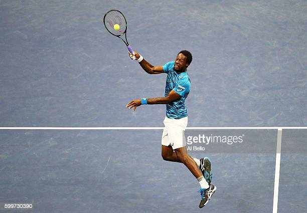 Gael Monfils of France returns a shot to Lucas Pouille of France during their Men's Singles Quarterfinal Match on Day Nine of the 2016 US Open at the...