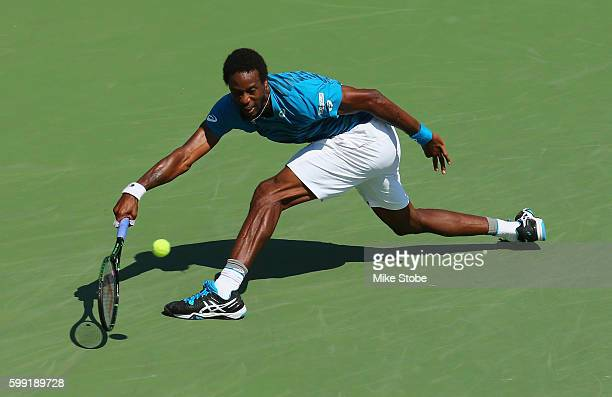 Gael Monfils of France returns a shot to Marcos Baghdatis of Cyprus during his fourth round Men's Singles match on Day Seven of the 2016 US Open at...