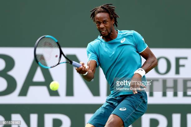 Gael Monfils of France returns a shot to PierreHugues Herbert of France during the BNP Paribas Open at the Indian Wells Tennis Garden on March 13...