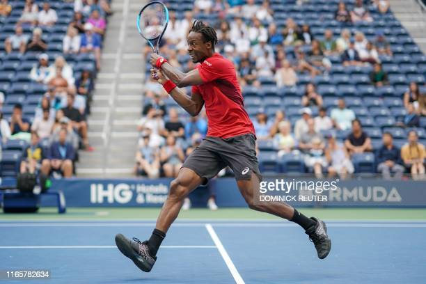 Gael Monfils of France returns the ball against Pablo Andujar of Spain in their Round Four Men's Singles tennis match during the 2019 US Open at the...