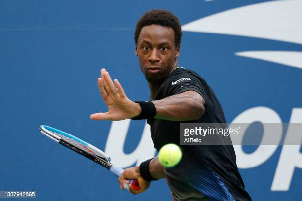 Gael Monfils of France returns the ball against Steve Johnson of United States during during his Men's Singles second round match on Day Four of the...