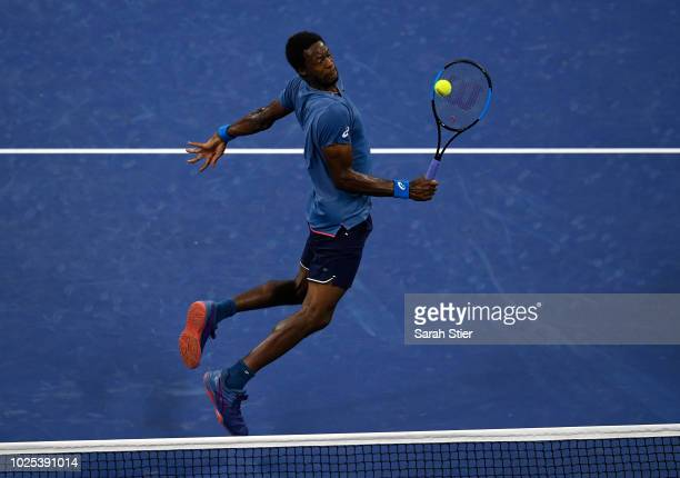Gael Monfils of France returns the ball during the men's singles second round match against Kei Nishikori of Japan on Day Four of the 2018 US Open at...