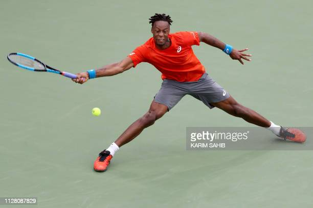 TOPSHOT Gael Monfils of France returns the ball to Lithuania's Ricardas Berankis during the ATP Dubai Tennis Championship in the Gulf emirate of...