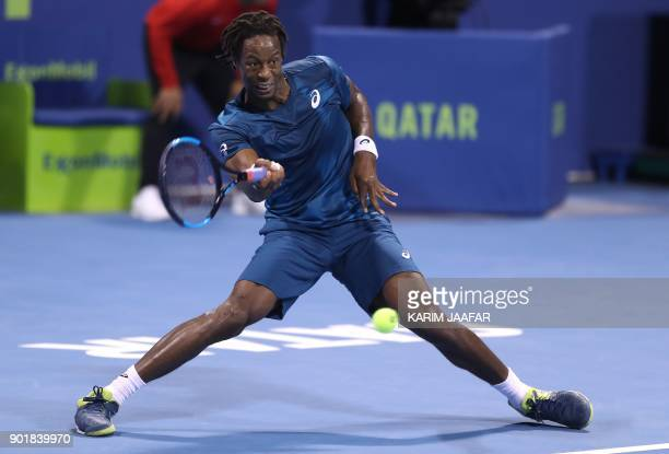 TOPSHOT Gael Monfils of France returns the ball to Russia's Andrey Rublev during the ATP Qatar Open tennis competition in Doha on January 6 2018 /...