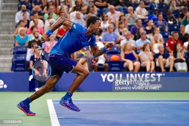 TOPSHOT Gael Monfils of France runs to hit a return against Kei Nishikori of Japan during their 2018 US Open men's Singles match at the USTA Billie...
