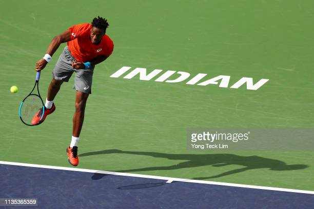 Gael Monfils of France serves against Albert RamosVinolas of Spain during their men's singles third round match on Day 8 of the BNP Paribas Open at...