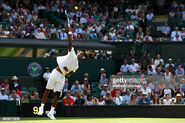 Gael Monfils of France serves against Sam Querrey of the United States during their Men's Singles third round match on day five of the Wimbledon Lawn...