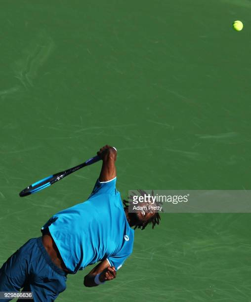 Gael Monfils of France serves during his match against Matthew Ebden of Australia during the BNP Paribas Open at the Indian Wells Tennis Garden on...